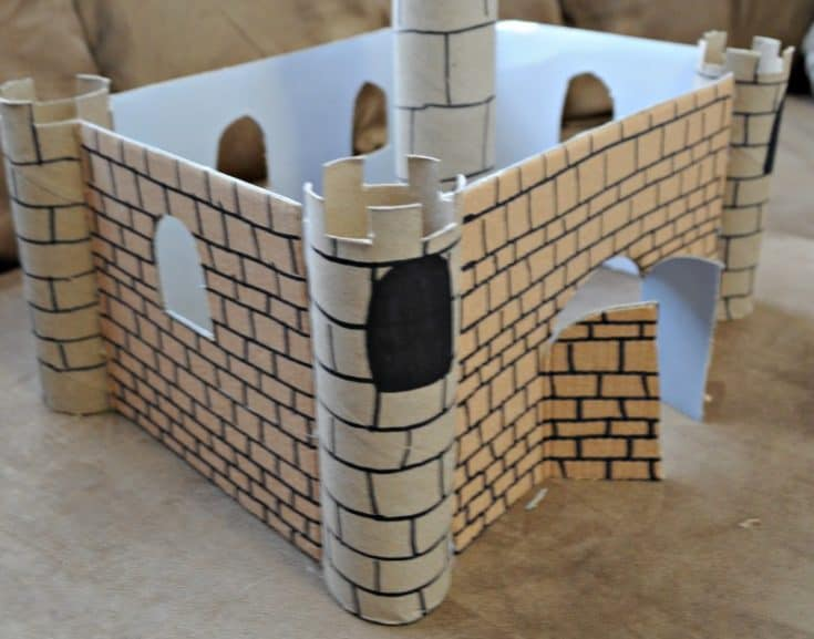 Here are step by step instructions on how to build a cardboard medieval castle with your child. Great opportunity to make memories, as this will take a bit of time to complete. But WOW! Once it's finished, they'll have loads of fun playing with it. #kidscrafts #medieval #castle #crafts #cardboardproject #cardboardcrafts #recycledcrafts #recycle
