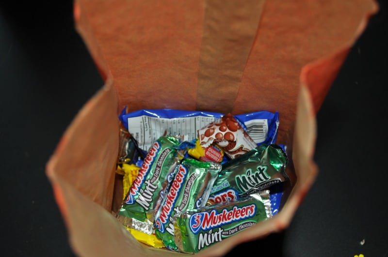 Fill treat bag with candy