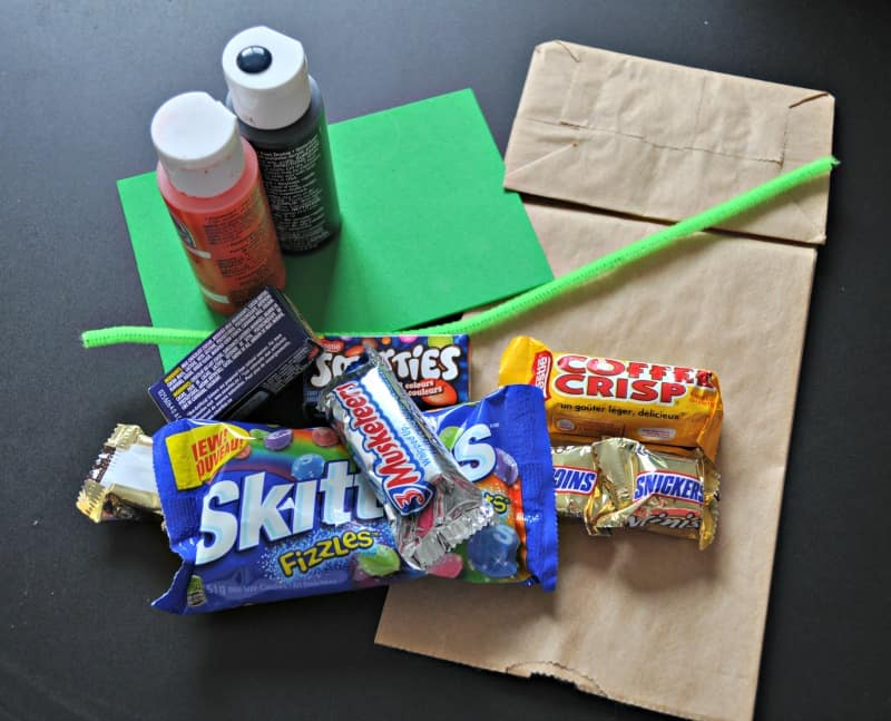 Materials needed to make a pumpkin treat bag