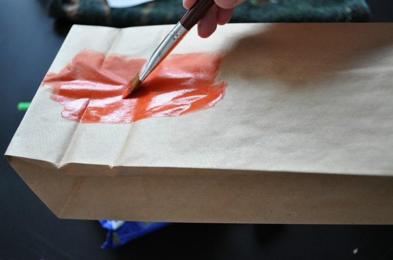 Painting the paper bag orange