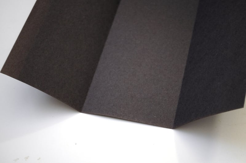 Fold construction paper in three