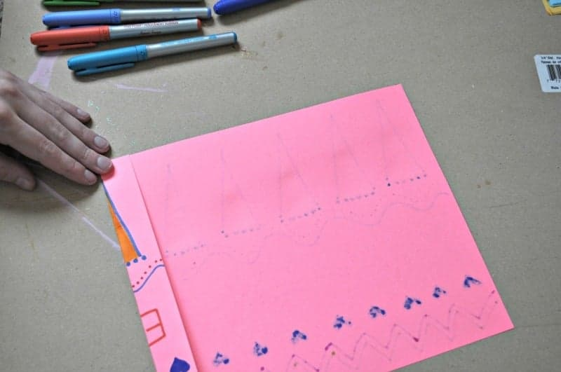 Folding pink paper for a fan
