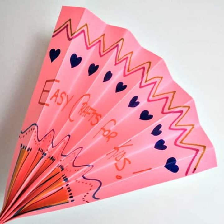 Pink folded paper fan