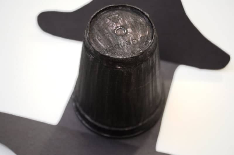 Glue styrofom cup to the folded paper