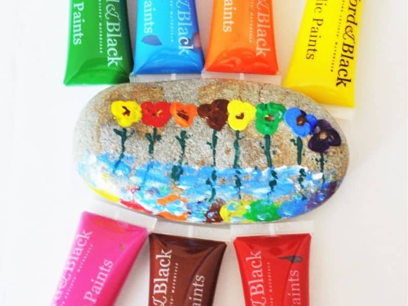 Finger painted rock: pretty flowers