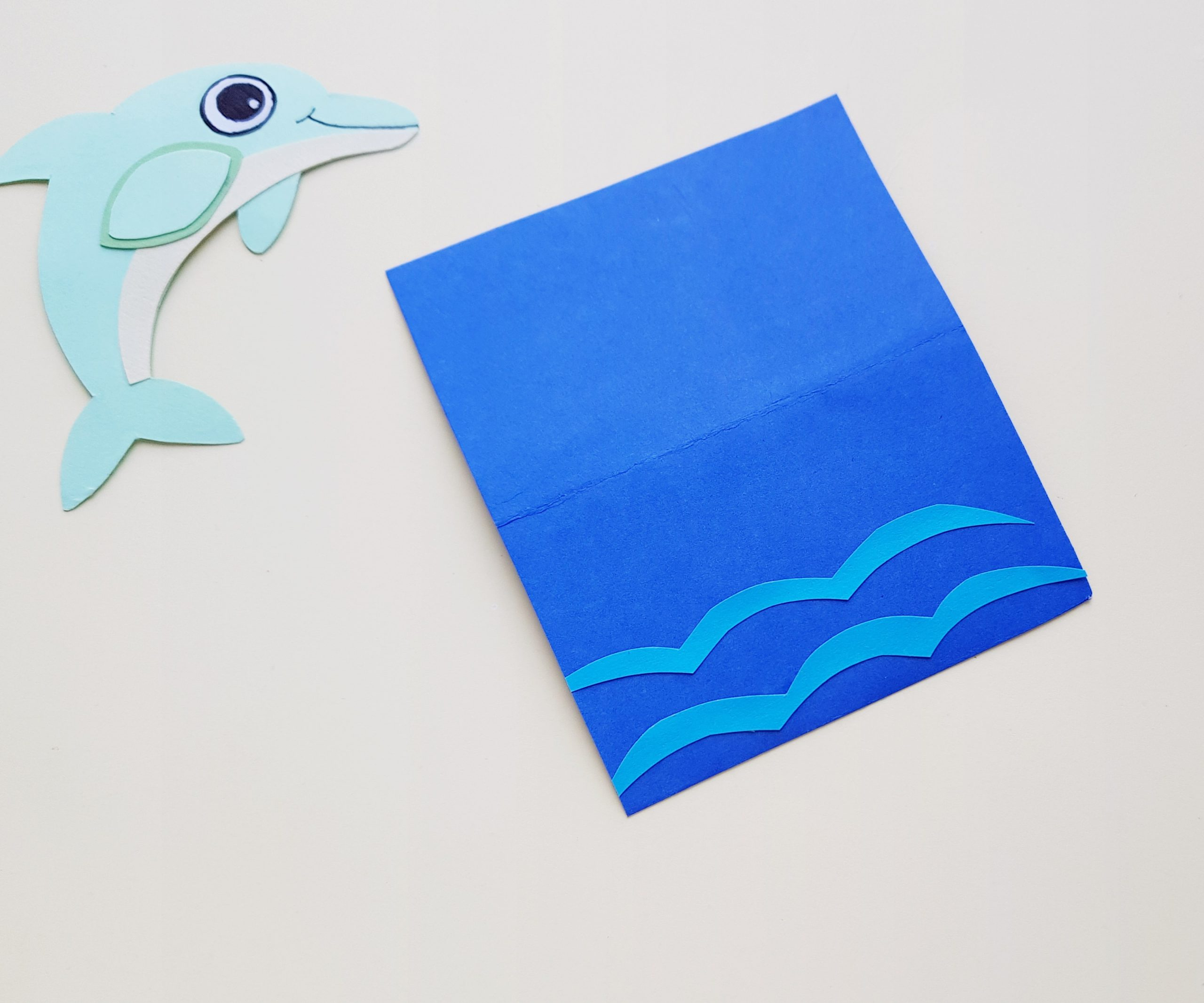 step by step dolphin craft with paper and scissors