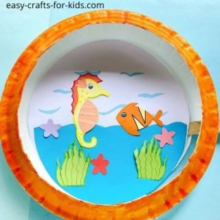 aquatic paper plate craft with seahorse and fish