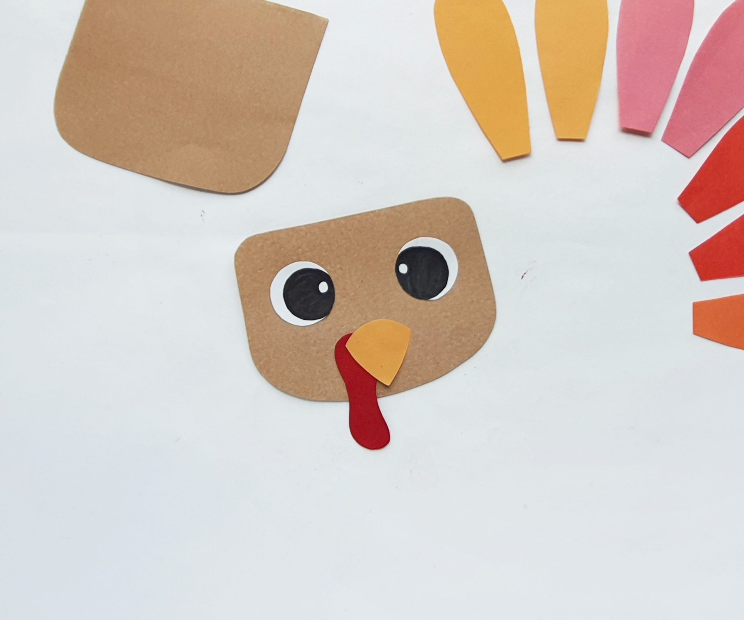 how to make a turkey puppet from a paper bag